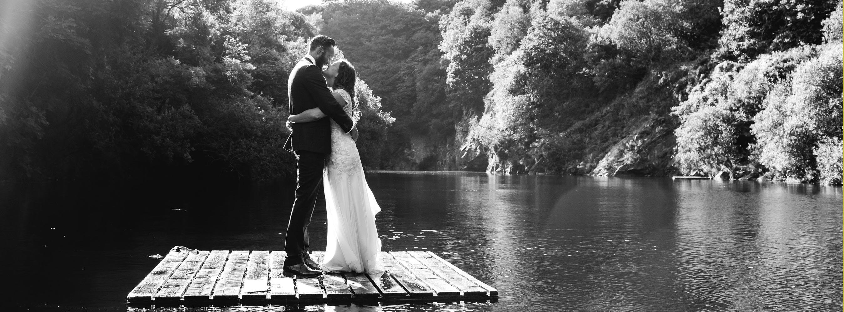 Bride and Groom floating on lake